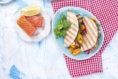 Mexican tacos with grilled vegetables and salmon. Healthy food for lunch. Fast food. Copy space.  Stock Photos