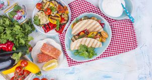 Mexican tacos with grilled vegetables and salmon. Healthy food for lunch. Fast food. Copy space.  Stock Image