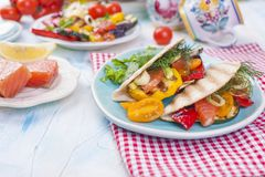 Mexican tacos with grilled vegetables and salmon. Healthy food for lunch. Fast food. Copy space stock photo