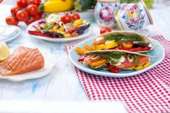 Mexican tacos with grilled vegetables and salmon. Healthy food for lunch. Fast food. Copy space.  Stock Images