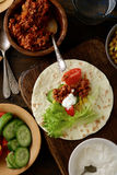 Mexican Tacos with ground beef, cucumber, tomato, corn and lettu Stock Photo
