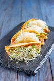 Mexican tacos with meat, beans, avocado, cheese and tomato sauce Stock Images