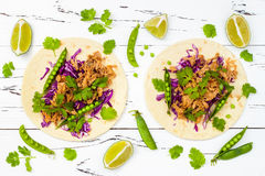 Mexican tacos with meat, peas and purple cabbage. Stock Photo