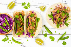 Mexican tacos with meat, peas and purple cabbage. Stock Photos