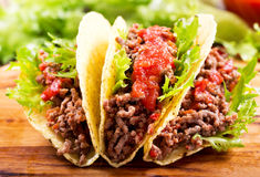 Mexican tacos with meat and salsa. On a wooden table royalty free stock image