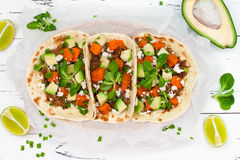 Mexican tacos with meat, sweet potatoes and cotija cheese. Royalty Free Stock Images