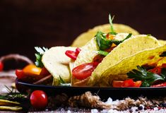 Mexican tacos stuffed with meat, beans, tomatoes and chili peppers, selective focus royalty free stock photos