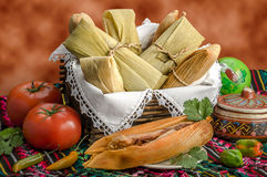 Mexican tamales made of corn and chicken. Tamales, Mexican dish made with corn dough, chicken and chili, wrapped with a corn leaf Royalty Free Stock Photos