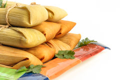 Mexican tamales made of corn and chicken isolated on white Stock Image