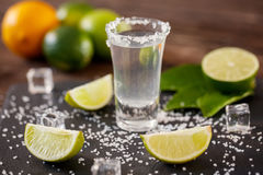 Mexican tequila in short glasses with salt, lime slices and ice Royalty Free Stock Photography