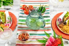 Celebrating Cinco de Mayo with margaritas and tacos. Mexican themed food and drink to celebrate Cinco de Mayo