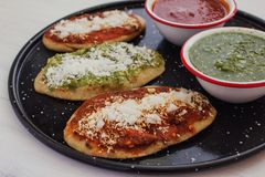 Mexican tlacoyos with green and red sauce, Traditional food in Mexico. Spicy food royalty free stock image
