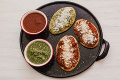 Mexican tlacoyos with green and red sauce, Traditional food in Mexico. Spicy food royalty free stock images