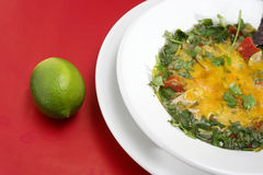 Mexican Tortilla Soup Closeup. Mexican tortilla soup on a red background Stock Photography