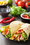 Mexican tortilla wrap chicken breast vegetables Royalty Free Stock Images