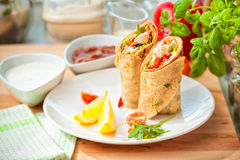 Healthy salmon wrap. Mexican tortilla Wrap with Peppers, Onions and a Herbs, Soft focus Royalty Free Stock Images
