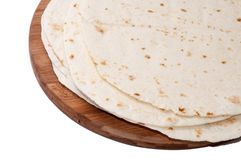 Mexican tortillas on a kitchen wooden board Royalty Free Stock Photos