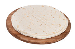 Mexican tortillas on a kitchen wooden board Stock Photo