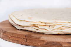 Mexican tortillas on a kitchen wooden board Royalty Free Stock Images