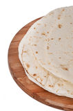 Mexican tortillas on a kitchen wooden board Stock Image