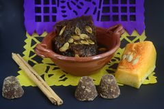 Mexican traditional pumpkin sweet made with piloncillo and cinammon on a clay pot, known as calabaza en tacha. Mexican traditional dessert for Day of Dead altar Stock Image