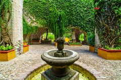 Mexican traditional fountain, tribute to the mining industry in colonial garden. San Gabriel Barrera Guanajuato Mexico royalty free stock image