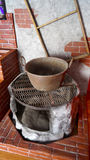 Mexican traditional saucepan made of copper over a stone furnace Royalty Free Stock Photography
