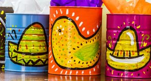 Mexican traditional style painted cans. Photograph of some metal cans with mexican symbols Royalty Free Stock Photo