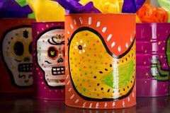 Mexican traditional style painted cans. Photograph of some metal cans with mexican symbols Stock Photo