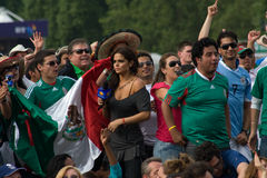 Mexican TV Presenter amongst the Mexico Fans. A TV Presenter for the Mexican Station Televisa mingles with Mexico fans watching the Olympic 2012 Football Final Stock Image