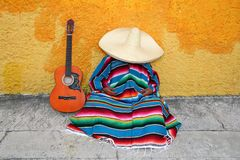 Mexican typical lazy man sombrero hat. Guitar serape nap siesta Royalty Free Stock Photo