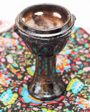 Mexican Vase. A traditional mexican vase for fire on a colorful fabric Royalty Free Stock Image