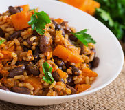 Mexican vegan vegetable pilaf with haricot beans and pumpkin Royalty Free Stock Photos