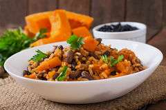 Mexican vegan vegetable pilaf with haricot beans and pumpkin Royalty Free Stock Images