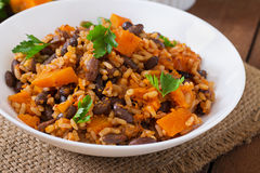 Mexican vegan vegetable pilaf with haricot beans and pumpkin Stock Photography