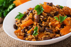 Mexican vegan vegetable pilaf with haricot beans and pumpkin Royalty Free Stock Image