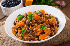 Mexican vegan vegetable pilaf with haricot beans and pumpkin Royalty Free Stock Photo