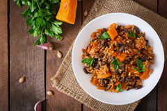 Mexican vegan vegetable pilaf with haricot beans and pumpkin Stock Photo