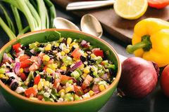 Mexican vegetable salad with black bean- cowboy caviar. Royalty Free Stock Images
