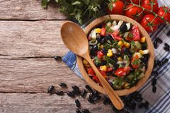 Mexican vegetable salad in a wooden bowl, close-up horizontal to Stock Image