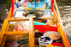 Mexican vendor of food on Xochimilco gondola trajinera Royalty Free Stock Photography