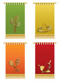 Mexican wall hangings. With gold tassel fringing, isolated on white Royalty Free Stock Images