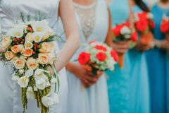 Mexican Wedding bouquet of flowers in the hands of the bride in mexico city. Mexican Wedding bouquet of flowers in the hands of the bride and bridesmaids in stock photo