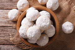 Mexican wedding cookies close up in a wooden bowl. Horizontal to Stock Images