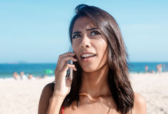 Mexican woman asking at phone Stock Image
