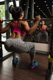 Mexican Woman Doing Exercise Barbell Squat Stock Images
