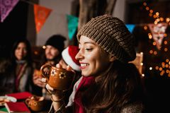 Free Mexican Woman Drinking Ponche Navideño Celebrating A Posada In Christmas Mexico Stock Image - 163714221