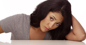 Mexican woman feeling sad. And looking at camera Royalty Free Stock Photography