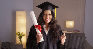 Mexican woman happily wearing cap and gown Stock Images