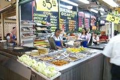 Mexican woman makes quesadillas Stock Photography